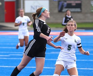 Canfield defender Ellie Accordino (16) head butts the ball as Lake Catholic midfielder Kennedy Newhart (5) watches on during the first half as Lake Catholic High School takes on Canfield High School in the Division II Regional Final, Saturday, Nov. 4, 2017, at Gilcrest Field at Portage Community Bank Stadium in Ravenna, Ohio. Lake won 2-0...(Nikos Frazier | The Vindicator)..