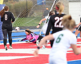 Lake Catholic forward Keka Babic (9) scores a goal against Canfield goalie Lauren Slanker (4) during the first half as Lake Catholic High School takes on Canfield High School in the Division II Regional Final, Saturday, Nov. 4, 2017, at Gilcrest Field at Portage Community Bank Stadium in Ravenna, Ohio. Lake won 2-0...(Nikos Frazier | The Vindicator)..