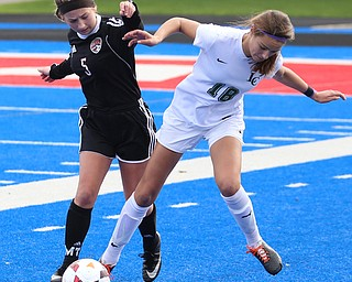 Lake Catholic defender Julia Marusic (18) and Canfield forward Marisa Scheetz (5) fight for the ball during the first half as Lake Catholic High School takes on Canfield High School in the Division II Regional Final, Saturday, Nov. 4, 2017, at Gilcrest Field at Portage Community Bank Stadium in Ravenna, Ohio. Lake won 2-0...(Nikos Frazier | The Vindicator)..