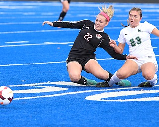 Canfield midfielder Chloe Kalina (22) and Lake Catholic forward Andrea Babic (23) fall down after fighting for the ball during the first half as Lake Catholic High School takes on Canfield High School in the Division II Regional Final, Saturday, Nov. 4, 2017, at Gilcrest Field at Portage Community Bank Stadium in Ravenna, Ohio. Lake won 2-0...(Nikos Frazier | The Vindicator)..