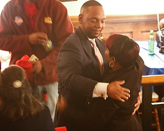 ROBERT K YOSAY  | THE VINDICATOR..Joyce Jones a close family friend... and Sean hug and exchange words at the  B&O station ...a hug and a thank you Sean McKinney enters the B&O station as results came down for Tito Brown Well wishers congratulated him on his race...-30-
