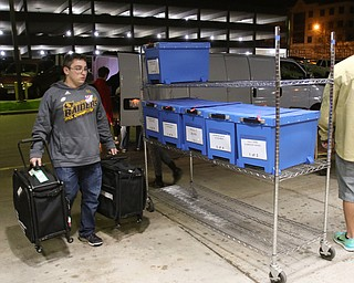 ROBERT K YOSAY  | THE VINDICATOR..The Ballots came in as Travis Bernard from South Range carry election materials from the trucks to the Bd of Elections..-30-
