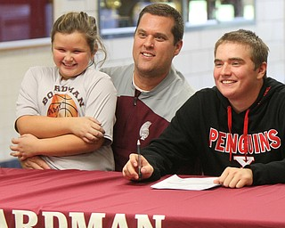 William D. Lewis The Vindicator  Brian Terlesky with his dad Brian Terlesky Sr (also golf coach) and sister Emma, 7, during signing day at Boardman HS 11-8-17.