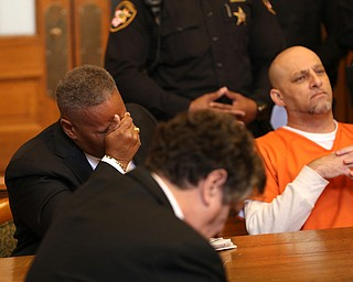Atty. Geoffrey Oglesby holds his head as Judge Ronald Rice reads the jury's verdict in Nasser Hamad's(right) aggravated murder case, Wednesday, Nov. 8, 2017, at the Trumbull County Court House in Warren. Hamad was sentenced to life in prison with parole eligibility after 30 years. ..(Nikos Frazier | The Vindicator)