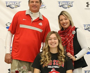 Adria Powell(center) poses for a photo with her parents, Greg(left) and Olivia Powell after signing her letter of intent to attend Ohio State University and play volleyball, Wednesday, Nov. 8, 2017, in the Hubbard High School Gymnasium in Hubbard...(Nikos Frazier | The Vindicator)