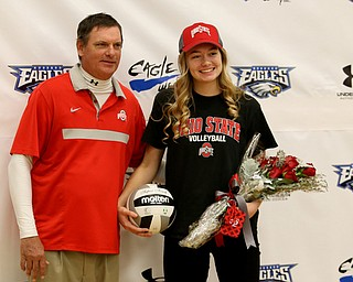 Adria Powell(right) and her father, Greg, pose for photos, Wednesday, Nov. 8, 2017, in the Hubbard High School Gymnasium in Hubbard. Powell plans on attending Ohio State University to play volleyball...(Nikos Frazier | The Vindicator)