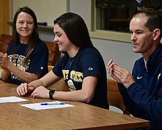 CORTLAND, OHIO - NOVEMBER 8, 2017: Annie Pavlansky smiles after signing her letter of intent while sitting next to her parents Tom, right, and Kate, Wednesday morning at Lakeview High School. DAVID DERMER | THE VINDICATOR