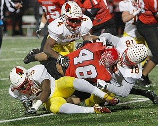ROBERT K YOSAY  | THE VINDICATOR..Gang Tackle SBR #48Jonathon Blackmon  get stopped by  CM#5 Nico Marchionda  #4 Darrion Fant and 18  Luke Fulton for no gain..Cardinal Mooney vs Steubenville Big Red at Salem Stadium...-30-