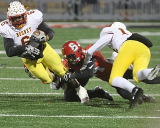 ROBERT K YOSAY  | THE VINDICATOR..CM# #6 breaks a tackle from SBR  #14Randy Mitchell as  CM#12 John Murphy - during first half action..Cardinal Mooney vs Steubenville Big Red at Salem Stadium...-30-