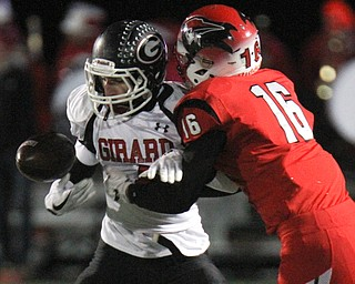 The Vindicator William D Lewis .Girard's Aiden Warga(4) tries to keep control of the ball while being tackled Perry's Jacob Allen(16) during 1rst half action at Twinsburg.
