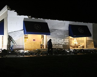 Workers begin repairs on the damage after a storm hit the Mahoning Valley, Sunday, Nov. 5, 2017, at the Ethan Allen Furniture Store in Boardman...(Nikos Frazier | The Vindicator)
