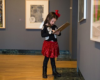 Chloe Morgan, 5 of Niles writes down her findings during a scavenger hunt activity during the Butler Institute of American Art Museum Family Fun Day on Sunday in Youngstown.