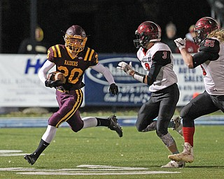 Josh Stear (20) of South Range tries to get to the corner around the tackle by Manchester's Coye Schuler during the first half of Friday nights matchup at Louisville High School in Louisville.  Dustin Livesay  |  The Vindicator  11/10/17  Louisville.