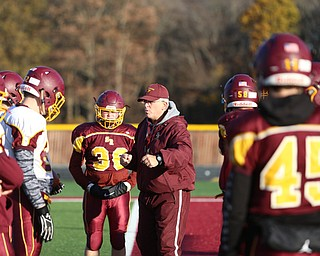 South Range Head coach Dan Yeagley runs his players through a drill during a post-season practice, Tuesday, Nov. 21, 2017, at South Range High School in Canfield...(Nikos Frazier | The Vindicator)