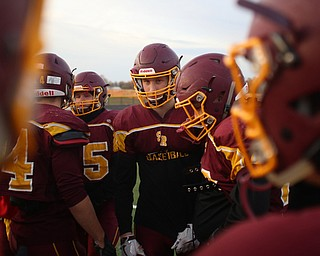 Aniello Buzzacco (14) in the huddle during a post-season practice, Tuesday, Nov. 21, 2017, at South Range High School in Canfield...(Nikos Frazier | The Vindicator)