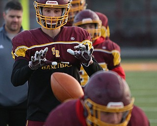 Aniello Buzzacco (14) catches the snap before handing the ball off during a post-season practice, Tuesday, Nov. 21, 2017, at South Range High School in Canfield...(Nikos Frazier | The Vindicator)
