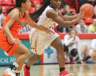 William D. Lewis the Vindicator  YSU's Indiya Benjamin(3) drives around Bucknell's Kyi English(2) during 11-24-17 action at YSU.