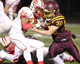 South Range's Anthony Czap (50) hits Eastwood's Jaden Rayford (26) during the first half of Friday nights matchup at Strongsville High School.Dustin Livesay |  The Vindicator  11/24/17  Strongsville.