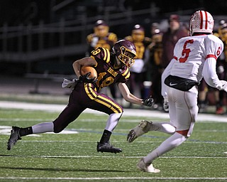 Mathias Combs (18) of South Range tries to outrun Eastwood's Gavin Slattman (5) to the sidelines during the second quarter of Friday nights matchup at Strongsville High School.Dustin Livesay |  The Vindicator  11/24/17  Strongsville.