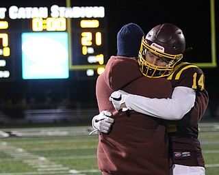 South Range's Aniello Buzzacco (14) gets consoled by his father David Buzzacco after the Raiders loss to Eastwood 21-7 on Friday night .Dustin Livesay |  The Vindicator  11/24/17  Strongsville.