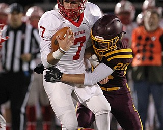 Eastwood quarterback Jake Pickerel (7) gets brought down in the backfield by South Range's Josh Stear (20) during the second half of Friday nights matchup at Strongsville High School.Dustin Livesay |  The Vindicator  11/24/17  Strongsville.