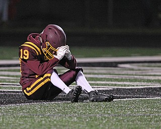 Brendan Miller sits down on the goal line as time runs out in the fourth quarter of Friday nights matchup against Eastwood at Strongsville High School. The Raiders lost 21-7 to the Eagles.   Dustin Livesay |  The Vindicator  11/24/17  Strongsville.
