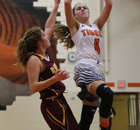 Howland's Mackenzie Maze (4) goes up for a layup during the second quarter of the Toni Ross Spirit Foundation basketball tournament, Saturday, Nov. 25, 2017, at Howland High School in Howland. South Range won 55-51...(Nikos Frazier | The Vindicator)..