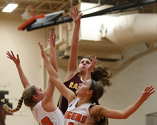 South Range's Izzy Lamparty (3) goes up for two as Howland's Gabby Hartzell (10) and Howland's Mackenzie Maze (4) try to block her shot during the third quarter of the Toni Ross Spirit Foundation basketball tournament, Saturday, Nov. 25, 2017, at Howland High School in Howland. South Range won 55-51...(Nikos Frazier | The Vindicator)..