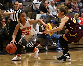 Howland's Ka'Rina Mallory (12) dribbles towards the basket against South Range's Brooke Sauerwein (20) during the fourth quarter of the Toni Ross Spirit Foundation basketball tournament, Saturday, Nov. 25, 2017, at Howland High School in Howland. South Range won 55-51...(Nikos Frazier | The Vindicator)..
