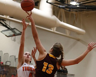 Howland's Mackenzie Maze (4) goes up for a layup against South Range's Maddi Durkin (13) during the fourth quarter of the Toni Ross Spirit Foundation basketball tournament, Saturday, Nov. 25, 2017, at Howland High School in Howland. South Range won 55-51...(Nikos Frazier | The Vindicator)..