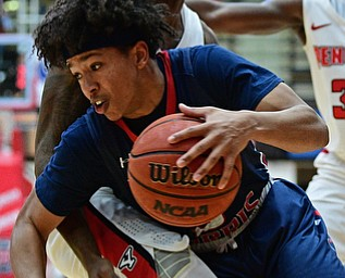 YOUNGSTOWN, OHIO - NOVEMBER 29, 2017: Robert Morris's Leondre Washington attempts to dribble away from the tight pressure from Youngstown State's Braun Hartfield during the second half of their game Wednesday night at Beeghley Center. Robert Morris won 81-74. DAVID DERMER | THE VINDICATOR