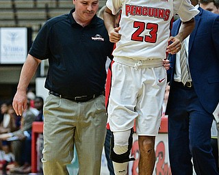 YOUNGSTOWN, OHIO - NOVEMBER 29, 2017: Youngstown State's Francisco Santiago hops off the floor after sustaining an injury during the second half of their game Wednesday night at Beeghley Center. Robert Morris won 81-74. DAVID DERMER | THE VINDICATOR