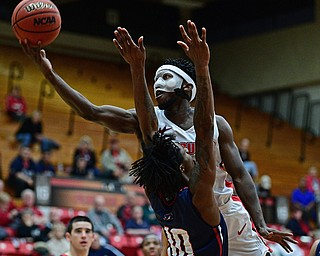YOUNGSTOWN, OHIO - NOVEMBER 29, 2017: Youngstown State's Jeremiah Ferguson goes to the basket against Robert Morris's Koby Thomas during the second half of their game Wednesday night at Beeghley Center. Robert Morris won 81-74. DAVID DERMER | THE VINDICATOR