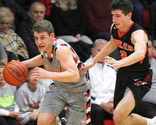 William D Lewis the vindicator Canfield's Ethan Kalina(12) drives past Marlingtons Blane Himmelheber(2) during 11302017 action at Canfield.