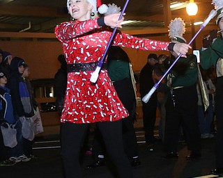 A twirler with the Ursuline High School Band performs during the annual Youngstown Christmas Parade and Tree lighting, Friday, Dec. 1, 2017, in downtown Youngstown...(Nikos Frazier | The Vindicator)