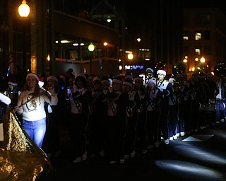 Members of the United Band perform during the annual Youngstown Christmas Parade and Tree lighting, Friday, Dec. 1, 2017, in downtown Youngstown...(Nikos Frazier | The Vindicator)