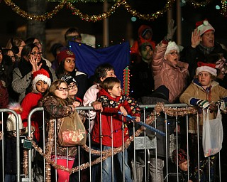 Onlookers during the annual Youngstown Christmas Parade and Tree lighting, Friday, Dec. 1, 2017, in downtown Youngstown...(Nikos Frazier | The Vindicator)