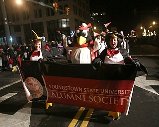 Members of the YSU Alumni Society walk with Pete the Penguin during the annual Youngstown Christmas Parade and Tree lighting, Friday, Dec. 1, 2017, in downtown Youngstown...(Nikos Frazier | The Vindicator)