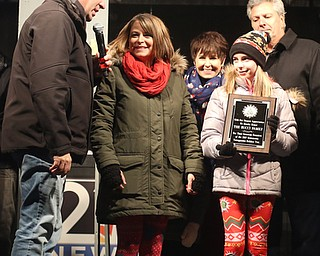 Members of the Bucci family are honored for their blue spruce Christmas tree donation during the annual Youngstown Christmas Parade and Tree lighting, Friday, Dec. 1, 2017, in downtown Youngstown...(Nikos Frazier | The Vindicator)