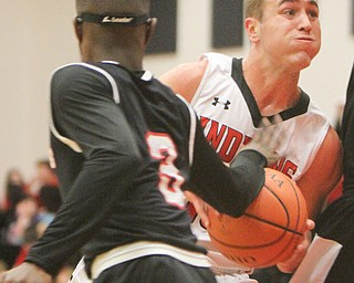 William D. Lewis Girard's Mark Waid (15) drives past Struther's Kevin Traylor(3) during 12012017 action at Girard.