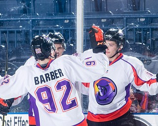 Scott R. Galvin | The Vindicator.Youngstown Phantoms center Alexander Barber (92) congratulates right winger Chase Gresock (19) on his goal during the second period against Team USA NTDP on Friday night at the Covelli Centre.