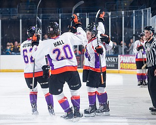 Scott R. Galvin | The Vindicator.Youngstown Phantoms defenseman Michael Joyaux (62) and center Curtis Hall (20) congratulate right wing Max Ellis (6) on his goal against Team USA NTDP on Friday at the Covelli Centre.