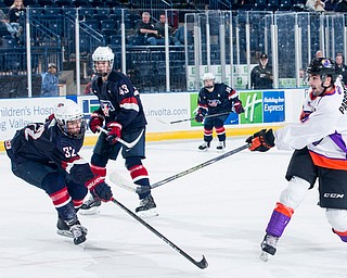 Scott R. Galvin | The Vindicator.Youngstown Phantoms left wing Tommy Parrottino (9) take a shot on goal during the third period against Team USA NTDP on Friday night at the Covelli Centre.