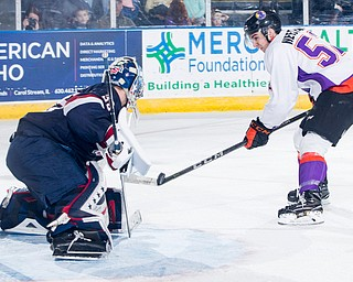 Scott R. Galvin | The Vindicator.Youngstown Phantoms left wing Craig Needham (52) takes a shot against Team USA goalie Spencer Knight during the third period on Friday at the Covelli Centre.