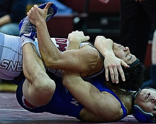 BOARDMAN, OHIO - DECEMBER 3, 2017: Boardman's Brandon Zigotti, top, attempts to break from from the control of Fitch's AJ Stehura during their 170lb bout, Saturday morning at Boardman High School. DAVID DERMER | THE VINDICATOR