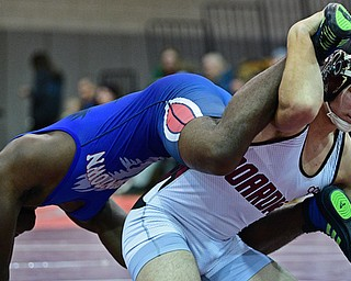 BOARDMAN, OHIO - DECEMBER 3, 2017: Boardman's Michael O'Horo controls the legs of Fitch's Willie Beverly during their 182lb bout, Saturday morning at Boardman High School. DAVID DERMER | THE VINDICATOR