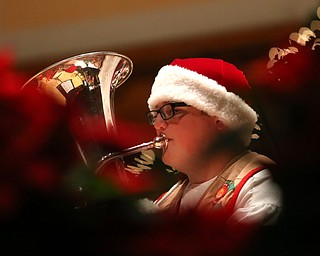 Cameron Thompson(16) of Niles plays the baritone during a holiday craft show and third annual Tuba Christmas, Sunday, Dec. 3, 2017, at Stambaugh Auditorium in Youngstown...(Nikos Frazier | The Vindicator)
