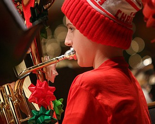 Thomas Russi(13) plays the baritone during a holiday craft show and third annual Tuba Christmas, Sunday, Dec. 3, 2017, at Stambaugh Auditorium in Youngstown...(Nikos Frazier | The Vindicator)