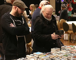 Karin McKinney(right) and her son, Rob McKinney of Warren look at custom coasters during a holiday craft show and third annual Tuba Christmas, Sunday, Dec. 3, 2017, at Stambaugh Auditorium in Youngstown...(Nikos Frazier | The Vindicator)