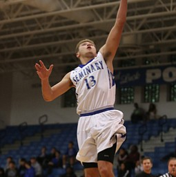 Poland's Brandon Barringer (13) goes up for a layup in the first quarter of an AAC high school basketball game against Harding, Tuesday, Dec. 5, 2017, in Poland. Poland won 57-40...(Nikos Frazier | The Vindicator)..